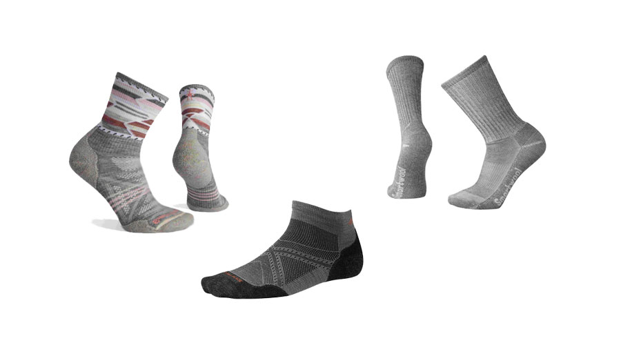 Three pairs of socks seemingly walking alone on a white background