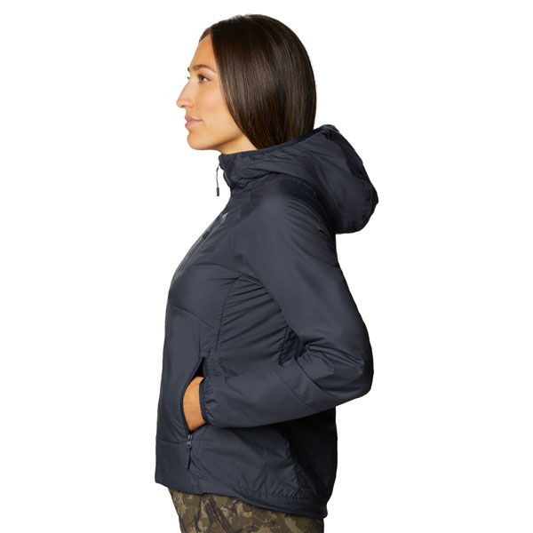 A woman wearing the dark Kor Cirrus™ Hybrid Hoody looking to climber left in profile.